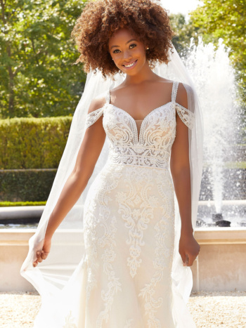 Both sweet and sultry, our Beatrix wedding gown is full of sculptured medallion lace appliqués covered in pearl and crystal beading.