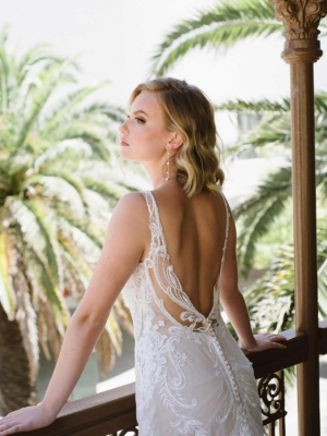 HIGH-NECK LACE WEDDING DRESS WITH SHEER DETAILS
